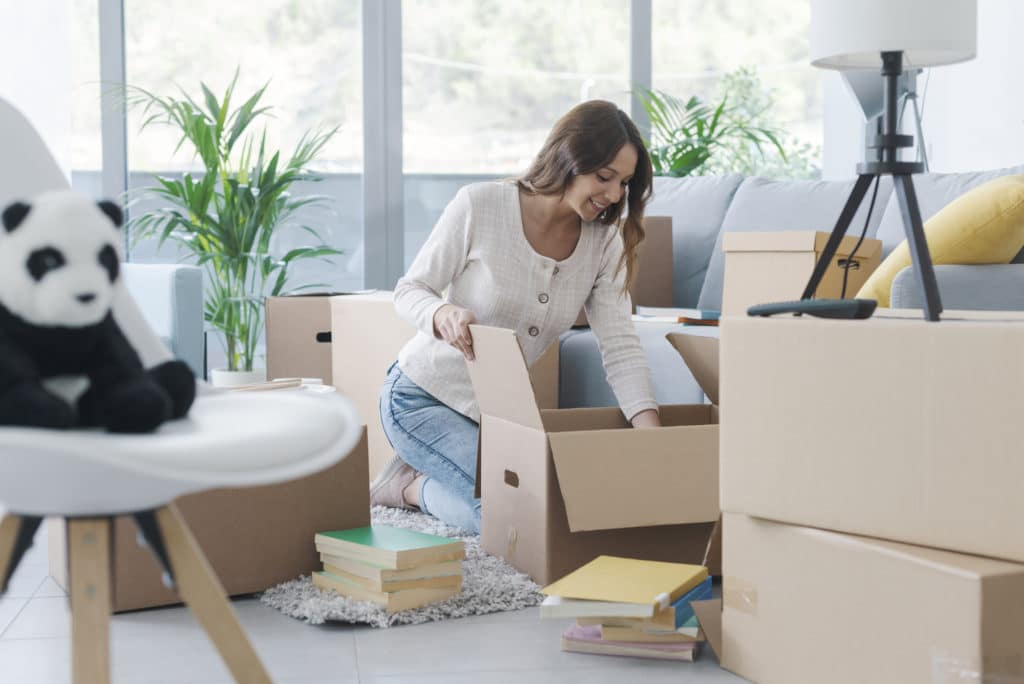 Woman unpacking in her new house